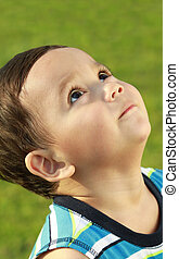 cute little boy hoping for something - young cute little boy...