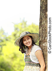 happy asian girl smiling in the park