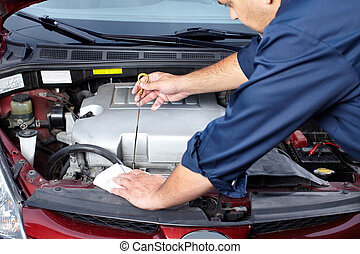 Auto repair. - hands of mechanic working in auto repair...