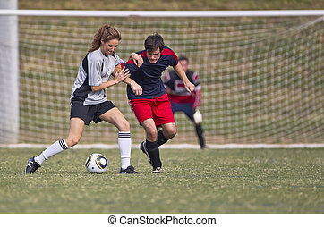 Soccer Players - Image of a male and female soccer player in...