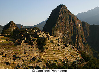 Machu Picchu at Sunrise - The ancient Incan ruin of Machu...