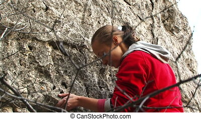 Woman climber - Girl rock climber climbs up the mountain Two...