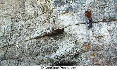 Professional climbing on the rock - Professional climber...