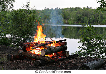 Campfire By the Lake in Summer Evening