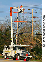 Worker fixing power line - Electrical Worker Fixing...