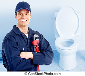 Plumber. - Young plumber near a flush toilet.