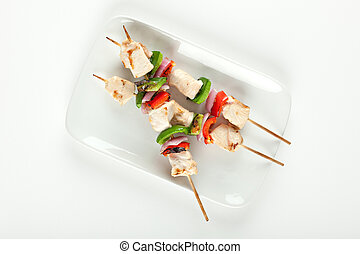 cubed chicken kabobs with red peppers, green peppers and red...
