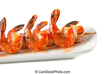 Closeup of BBQ shrimp skewers with sweet garlic chili sauce...
