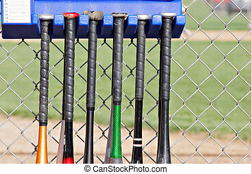 baseball bats - Baseball bats hanging outside the dugouts