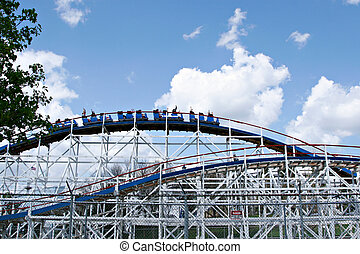 theme park roller coaster under blue sky