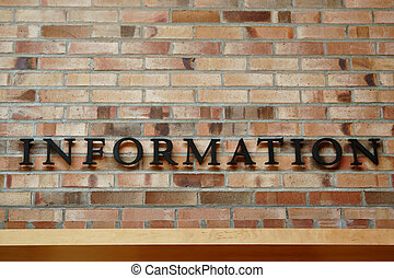 Information Sign on Brick Wall