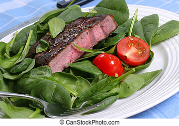 Grilled Beef Ribeye with Spinach and Tomatoes