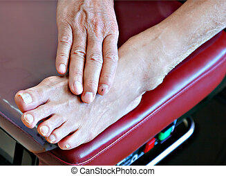 senior patient foot on examination bench - diabetic patient...