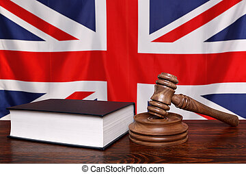UK law - Still life photo of a gavel, block and law book on...