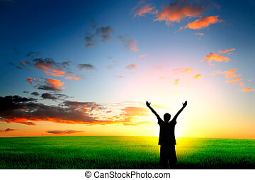 person on evening landscape - happy person in the field on...
