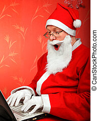 santa claus - surprised santa claus with notebook