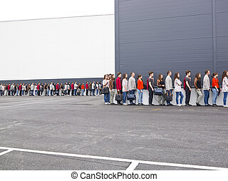 Waiting in Line - Large group of people waiting in line