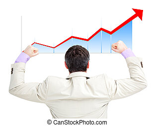 Successful businessman with the fists up looking at a...