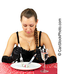 Beautiful woman have a dinner with five dollars on the plate