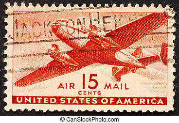 Postage stamp USA 1941 Twin-motored transport plane - UNITED...
