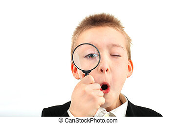 schoolboy - amazed schoolboy with loupe isolated on the...