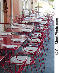 Outdoor cafe - cafe with red chairs outside