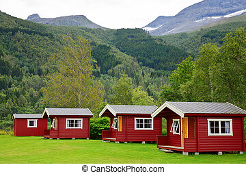 Camping cabins - Red wooden cabins at campsite in Norway