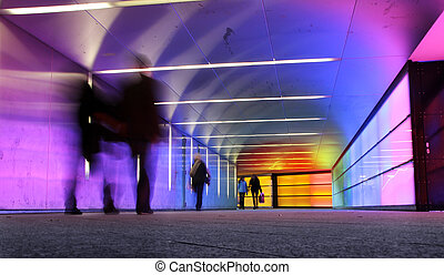 motion people - multi colored underground tunnel with people...