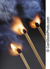 Match Ignition - Three safety matches igniting simultaneosly