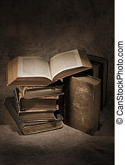 Old Books - Still life of old antique books. The open book...