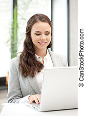 happy woman with laptop computer - picture of happy woman...