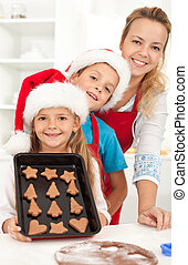 Happy family baking gingerbread cookies - Happy family at...
