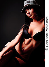 black - Shot of a sexy woman in black lingerie over dark...