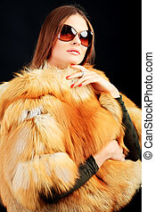 fur coat - Portrait of a beautiful young woman in a fur.