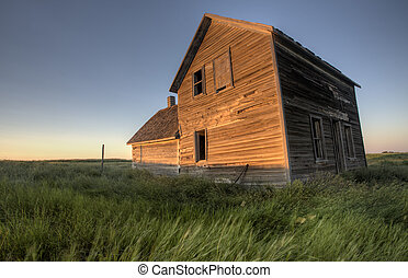 Abandoned Farmhouse Saskatchewan Canada sunset and prairie...