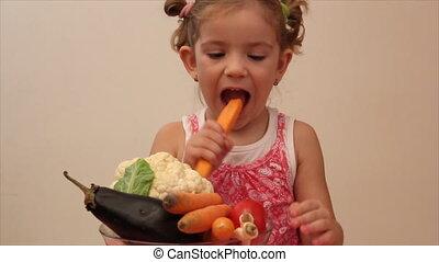 little girl eat carrot