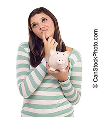 Ethnic Female Daydreaming and Holding Piggy Bank on White