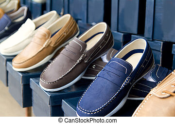 classic man shoes colorful in a row on outdoor shop