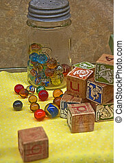 Vintage Marble and Block Toys - This antique still life...