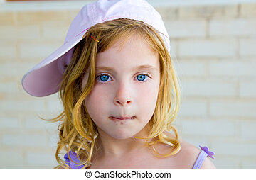 blond child girl gesturing funny with chocolate