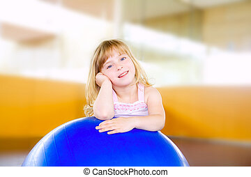 child little girl with gym aerobics ball relaxed