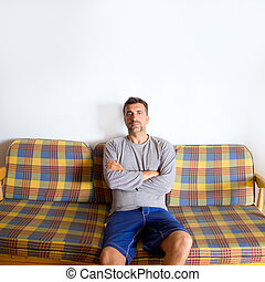 retro mustache man sitting in vintage sofa crossed arms