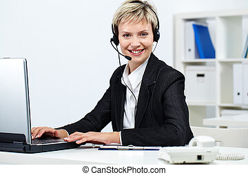 Friendly receptionist - Young pretty receptionist with...
