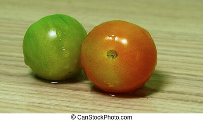 Dolly shot of two tomatoes on the wooden desk table