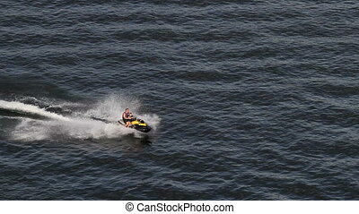 Jet skiing on summer lake