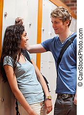 Portrait of a young couple flirting in a corridor