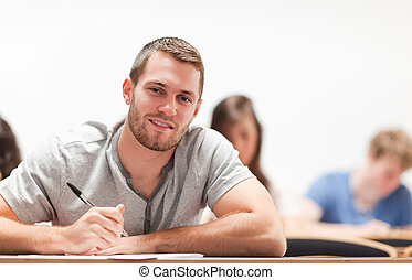 Smiling student sitting