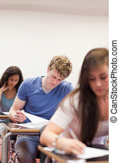 Portrait of young students doing an assignment