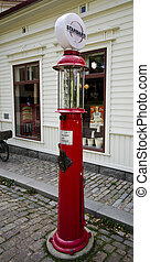 gas pump - an old gas pump on a stone cobbled street