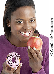 Woman Choosing Between Apple And Doughnut